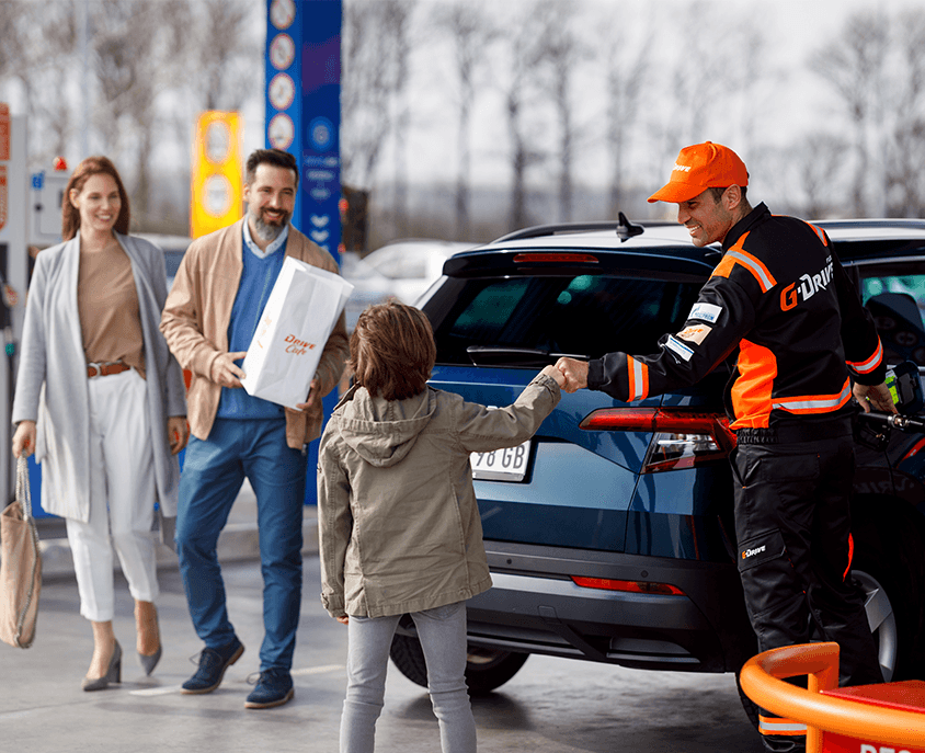 family at the petrol station