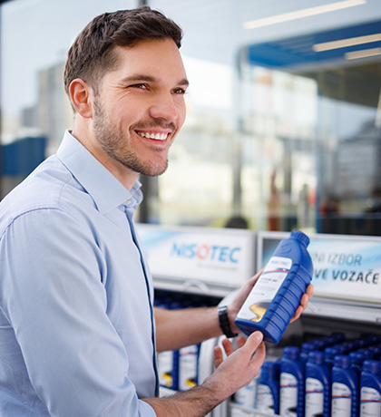 man smiling and holding nisotec product